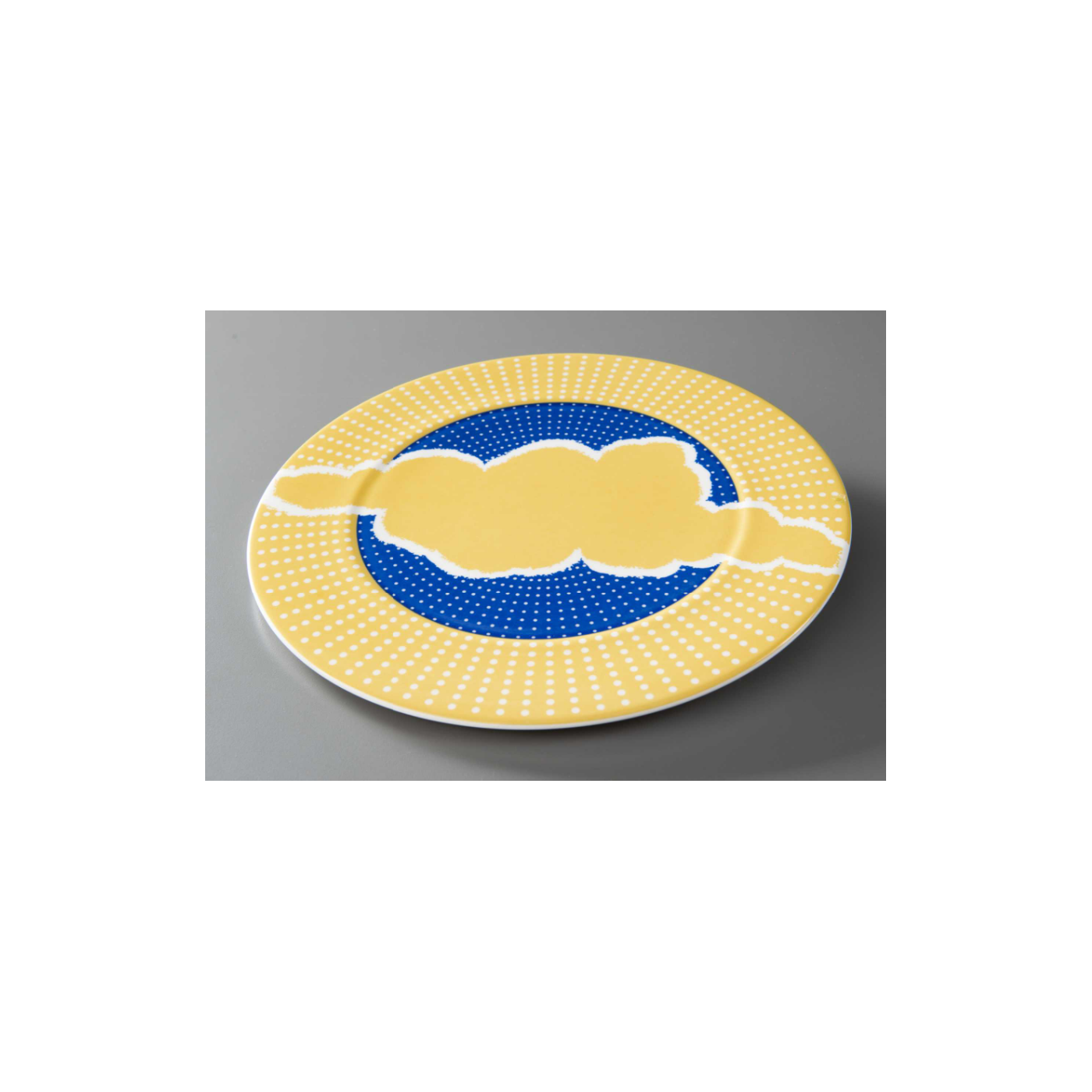 Plate charger designed for the Windows on the World restaurant. The charger is blue and yellow with a yellow cloud motif and small white dots that radiate from the center.