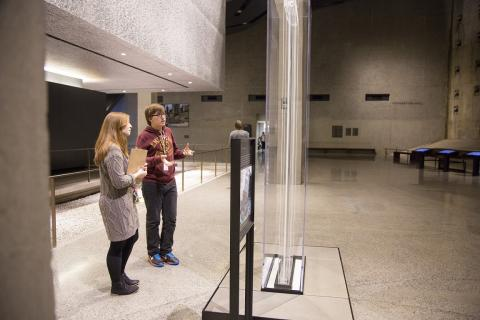 Christopher Demarest, a sophomore  at Bard High School Early College in Queens, speaks with 9/11 Memorial Museum Educational Specialist Chelsea Pellissier.