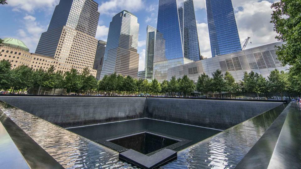 This panoramic shot is taking from southeast corner of the north pool of the Memorial, looking northward and upward toward the soaring One World Trade.